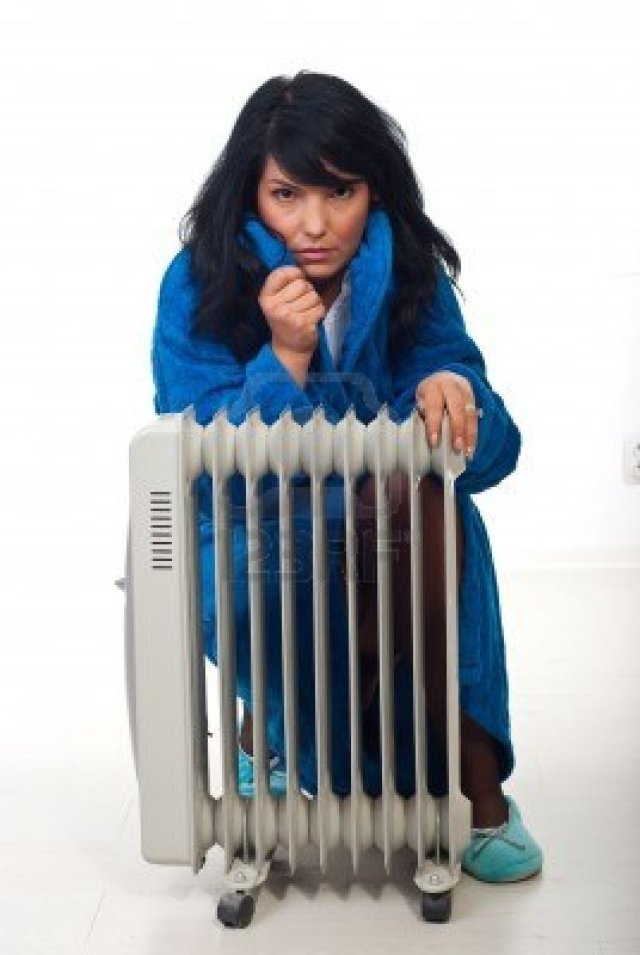 8042126-woman-shivering-and-sitting-near-radiator-trying-to-heat-up