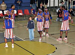 250px-Harlem_Globetrotter_playing_with_spctators_01